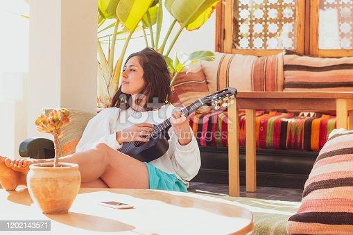 istock Woman playing Ukelele 1202143571