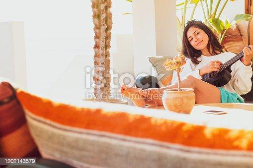 istock Woman playing Ukelele 1202143579