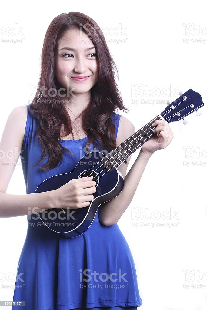 woman playing ukulele royalty-free stock photo