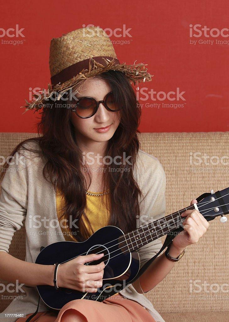 Woman playing ukulele. royalty-free stock photo