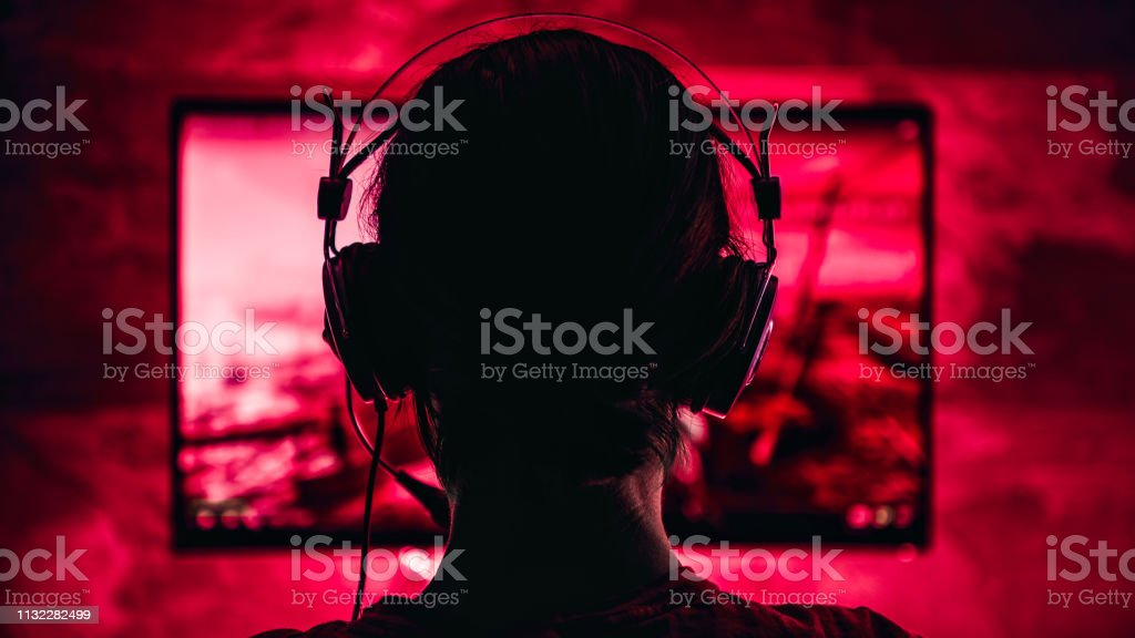 Woman playing video games stock photo