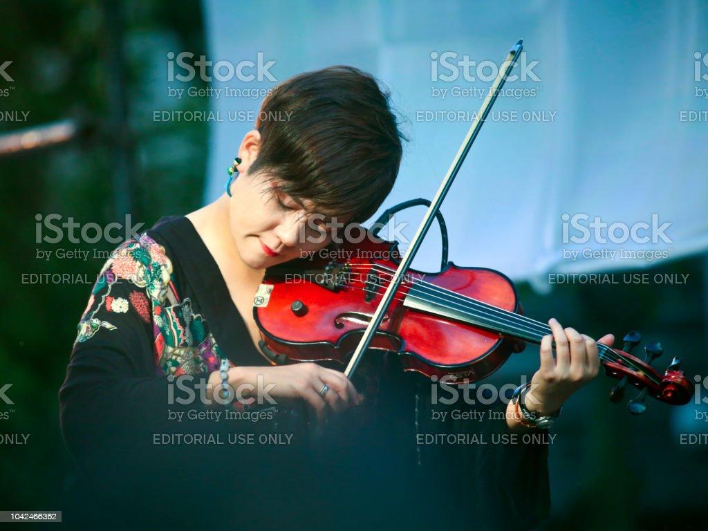 Woman Playing Violin at Noge's Jazz de Bon Odori 2018 stock photo