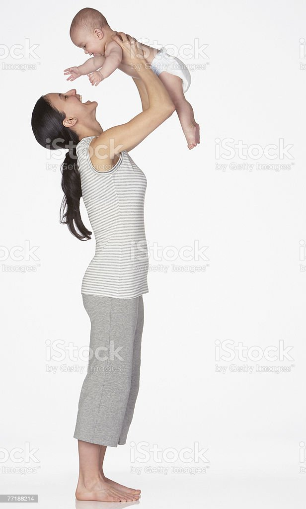 A woman playing with a baby stock photo