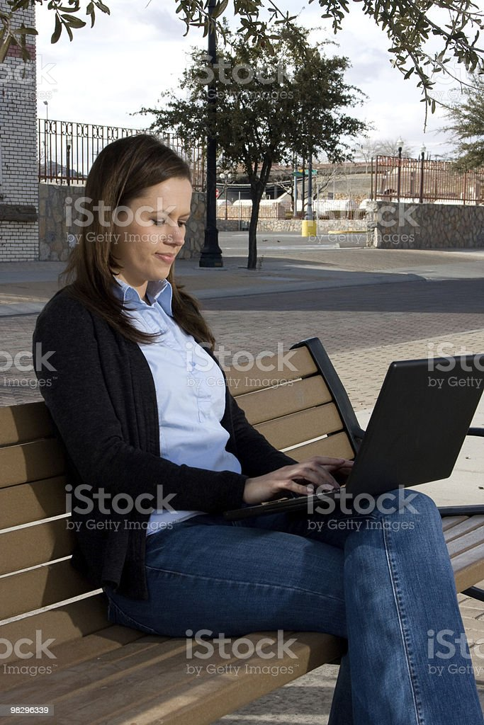 woman playing with a lap top royalty-free stock photo