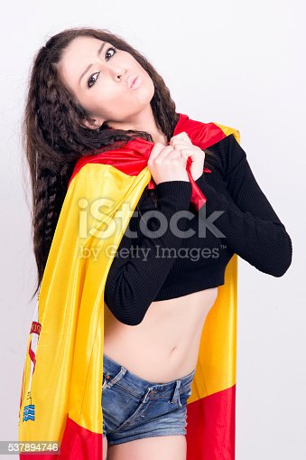 537894724 istock photo Woman playing with a spanish flag, like a superhero. 537894746
