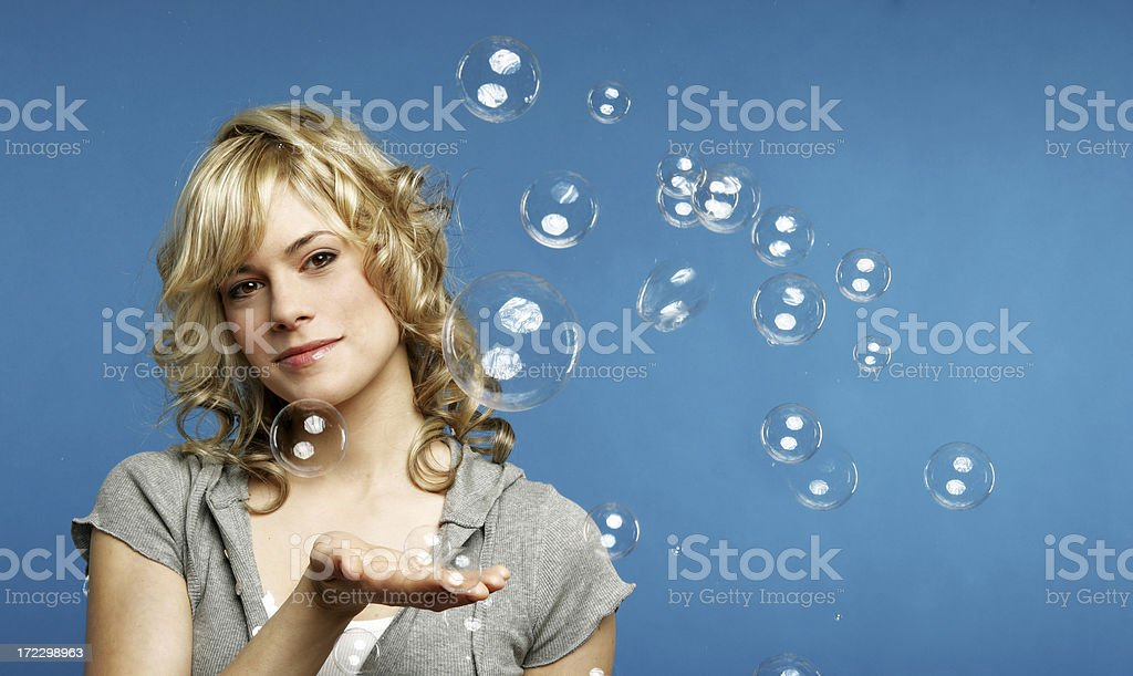 Woman playing with bubbles royalty-free stock photo