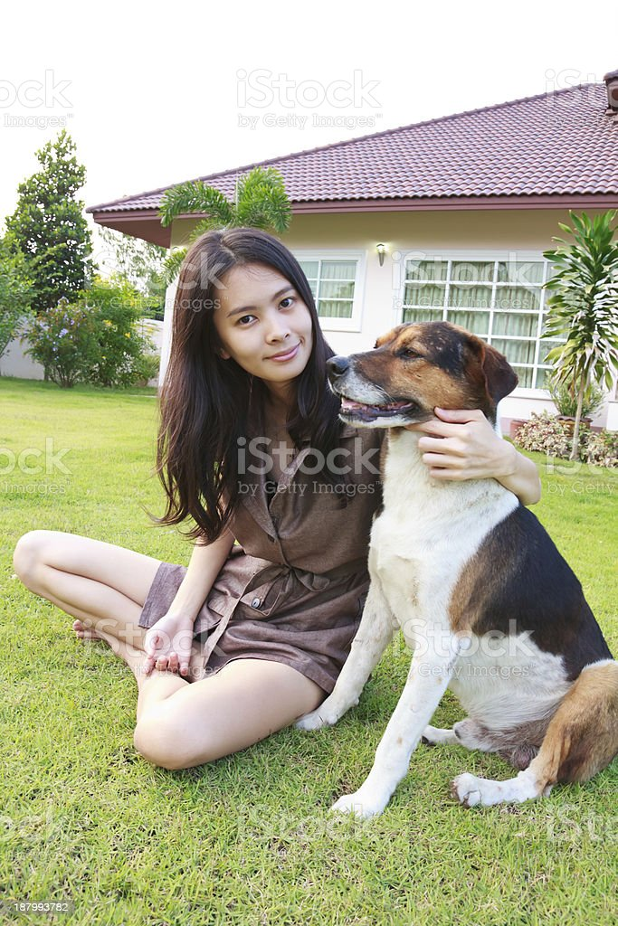 Woman playing with dog royalty-free stock photo