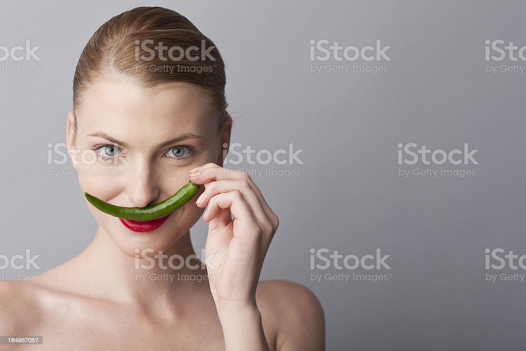 woman playing with green hot pepper royalty-free stock photo