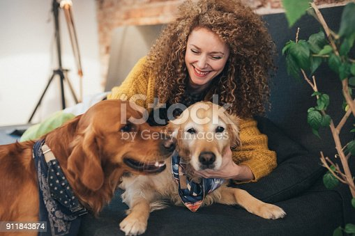 istock Woman playing with her dogs 911843874