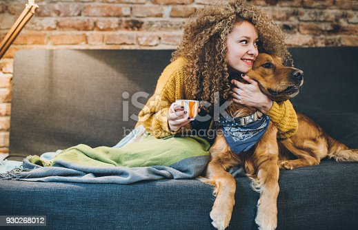 istock Woman playing with her dogs 930268012