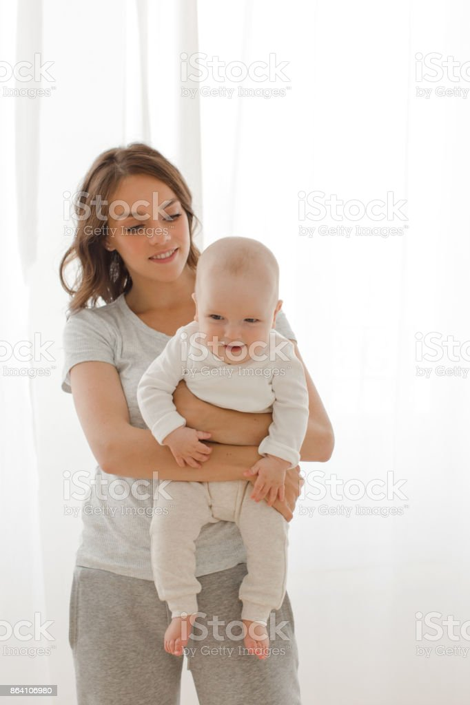 Woman playing with infant child royalty-free stock photo