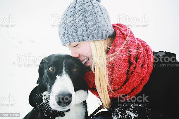 Woman playing with the dog in fresh snow picture id538143395?b=1&k=6&m=538143395&s=612x612&h=l6e5ucoz3zee8bra4uhvnb6brijmuoqq0pvgebgs3gu=