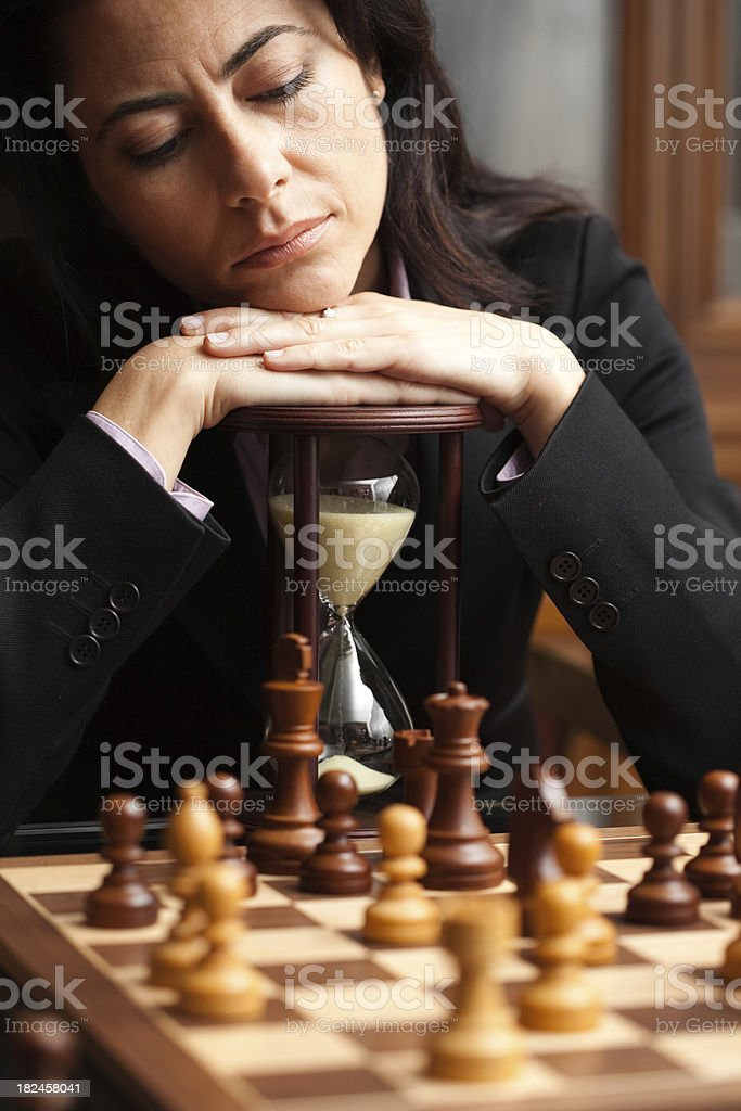Woman plays chess royalty-free stock photo