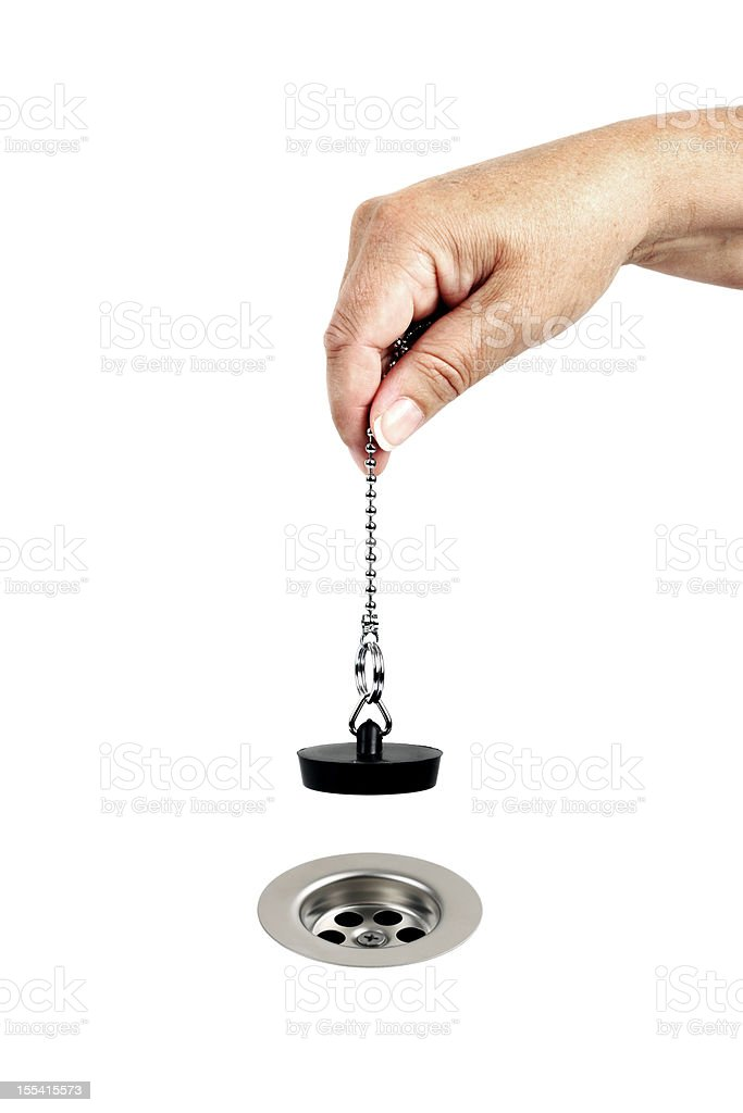 Woman Plugging Hole, or Sink Drain stock photo