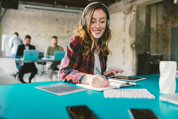 Woman podcasting in modern office stock photo