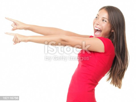 Pointing woman excited. Happy surprised woman pointing to the side, standing in profile. Isolated on white background. Click for more: