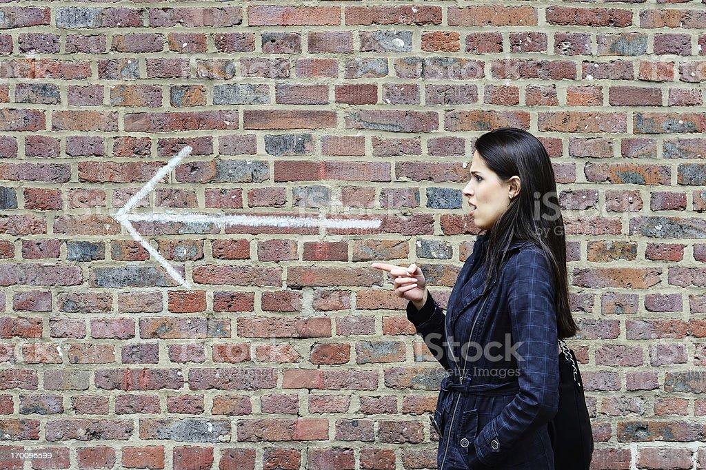 Woman pointing  forward stock photo