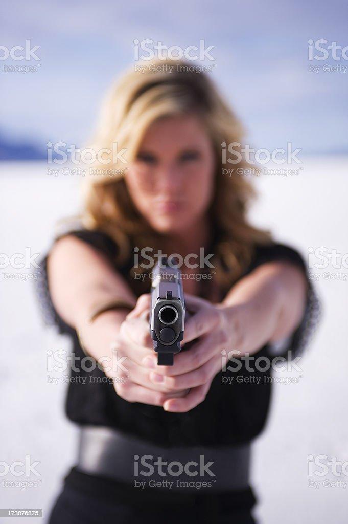 Woman pointing gun stock photo