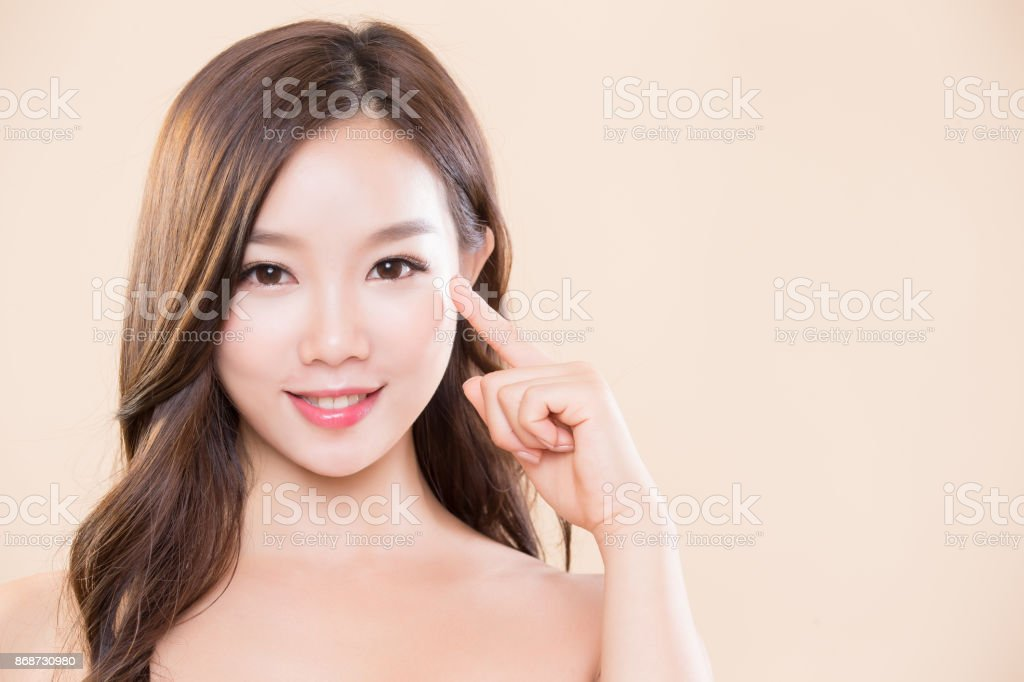 woman pointing her eye stock photo