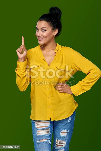 istock Woman pointing her finger up 496987602