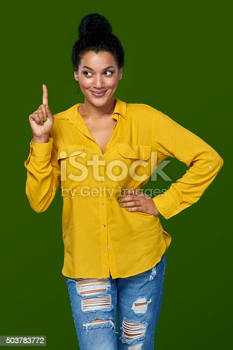 istock Woman pointing her finger up 503783772