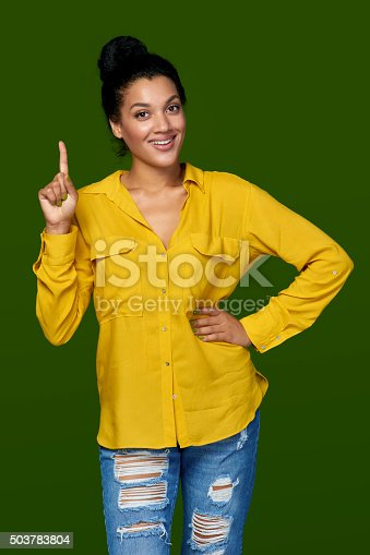 istock Woman pointing her finger up 503783804
