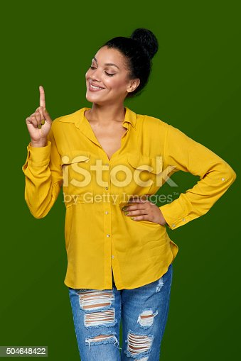 istock Woman pointing her finger up 504648422