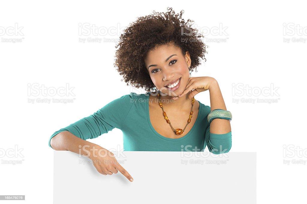 Woman Pointing On Billboard stock photo