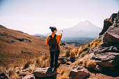 Young Latin woman enjoying the view to Popocatepetl volcano