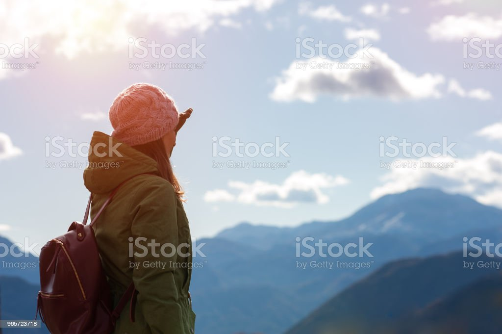 Woman points by finger at highest peak of hills - Royalty-free Adult Stock Photo
