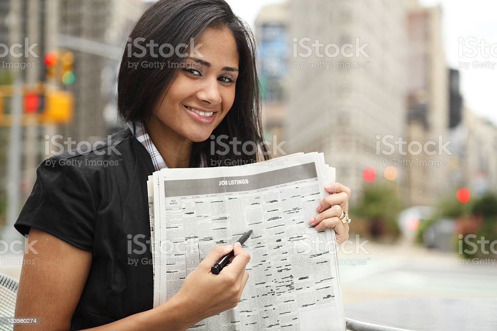 Woman Points to Job Listings royalty-free stock photo