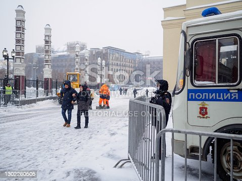 istock A woman police officer in a protective mask is on duty outside the Moscow Kremlin on a winter day during heavy snow. 1302260505