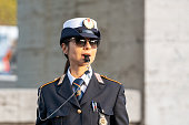Rome, Italy - 29.10.2019: Woman police officer in uniform regulates traffic. Travel.