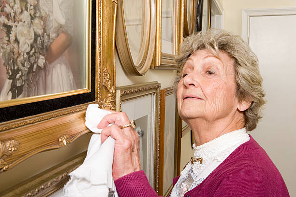 woman polishing picture frames - curator stock pictures, royalty-free photos & images