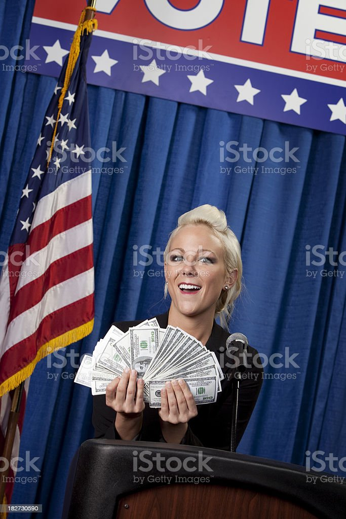 Woman politician greedy with money royalty-free stock photo
