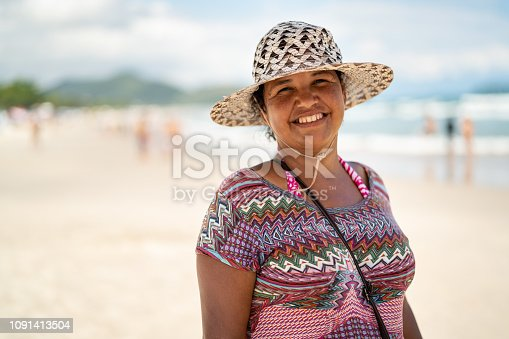 825083304 istock photo Woman Portrait at Beach 1091413504