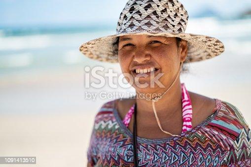 825083304 istock photo Woman Portrait at Beach 1091413510