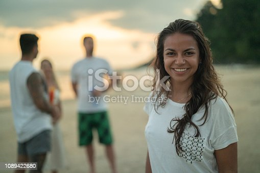 istock Woman Portrait Celebrating Beach Holiday Party 1089422680