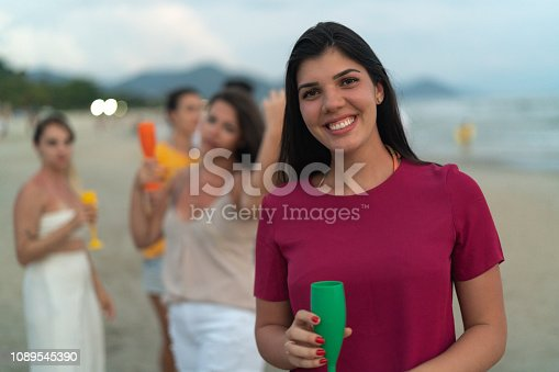 istock Woman Portrait Celebrating Beach Holiday Party 1089545390