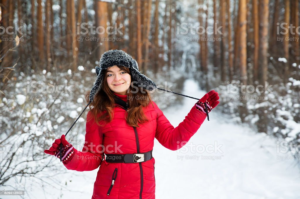 Woman portrait in fur winter hat with ear flaps stock photo