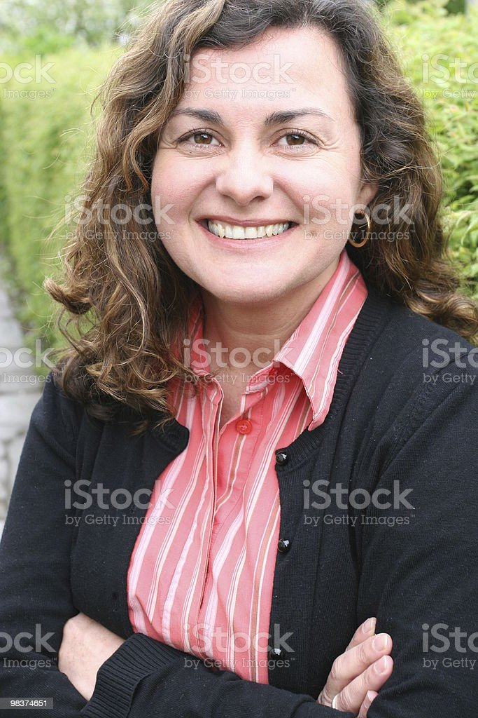 Woman portrait, looking, with folded arms royalty-free stock photo