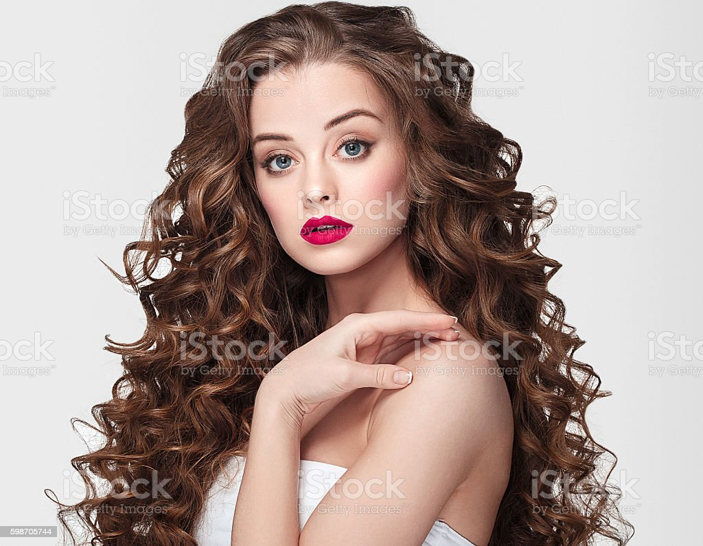 Woman portrait with curly hair perfect make up red lips. stock photo