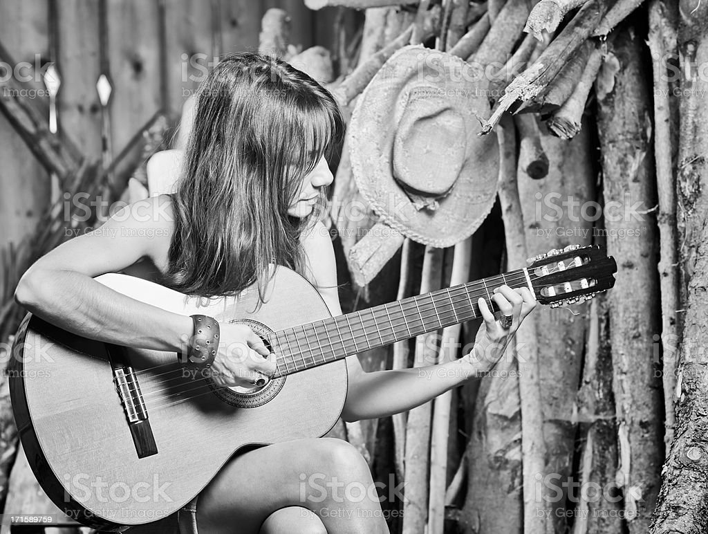 Woman portrait with guitar. Black and White stock photo