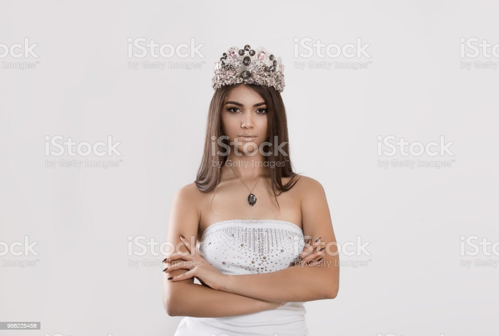 Woman poses for magazine wearing crown stock photo