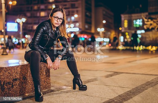 Young woman posing in the town square
