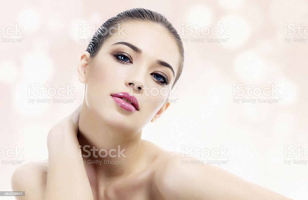 Woman posing for a shot with skin-colored background stock photo
