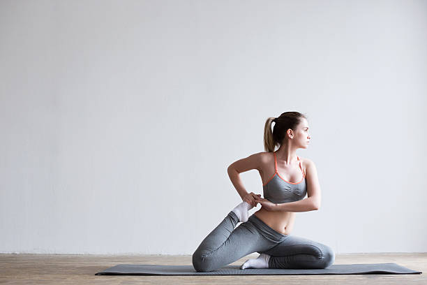 Woman posing in a gym. stock photo