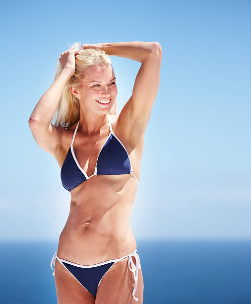 woman posing in bikini - older women bikini stock pictures, royalty-free photos & images