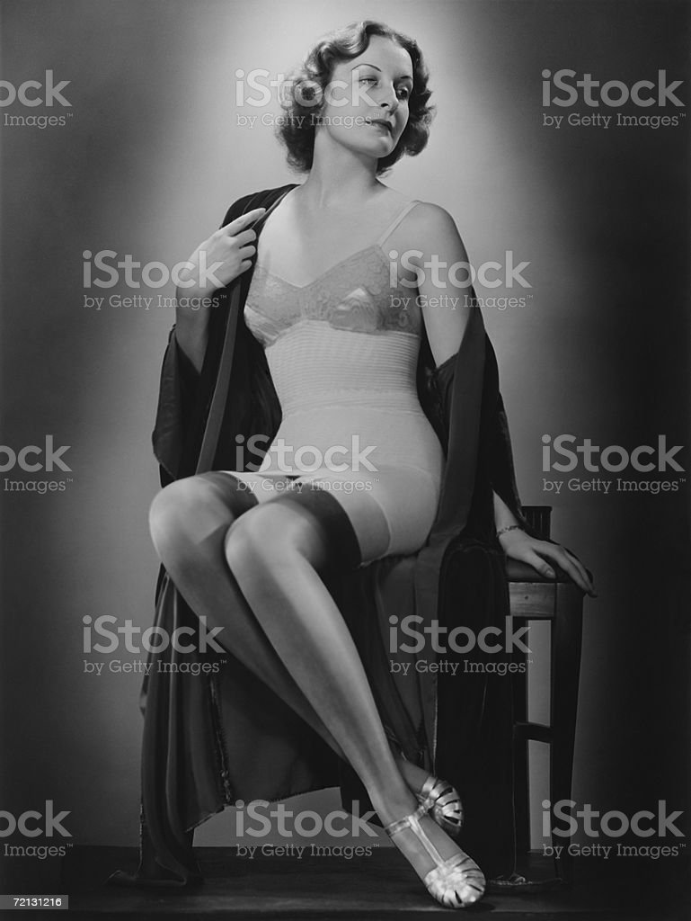 Woman posing in corset and stockings (B&W), portrait stock photo