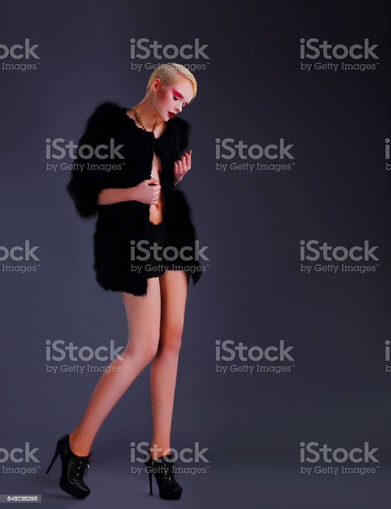 Woman posing in full growth. stock photo